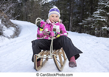 winter sports  - girl have fun on sledge in winter