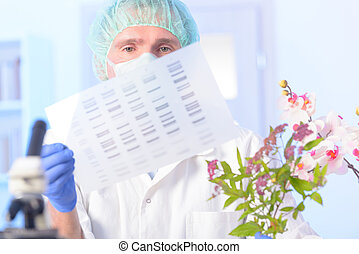 Analizing DNA GMO - Scientist analizing DNA sequence for GMO...