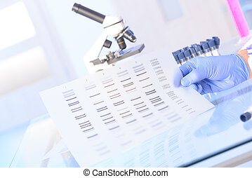 Analizing DNA - Scientist analizing DNA sequence for...