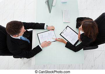 Businesswoman Interviewing Male Candidate In Office -...