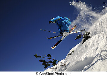 Extreme skier jumping .