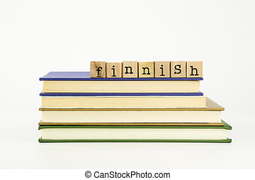 finnish language word on wood stamps and books - finnish...