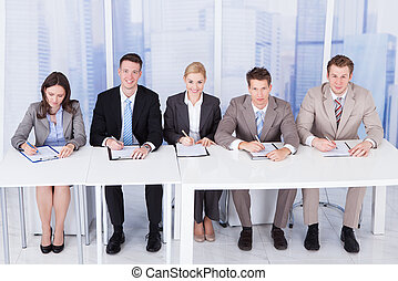 Corporate Personnel Officers Sitting At Table - Panel of...