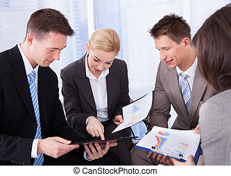 Business People Discussing In Office - Group of young...