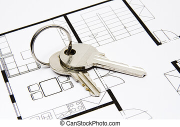 Key to housing - Key situated on blueprint of house - estate...