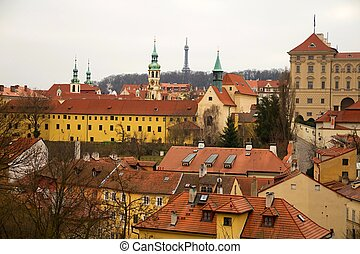 Prague and its red roofs, hidden streets and old houses