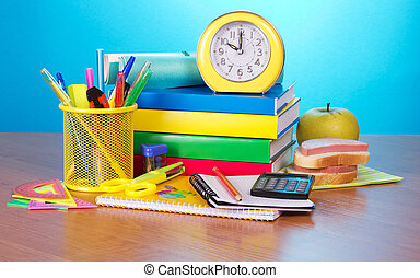 Pile of books, office supply, apple and sandwich - Pile of...