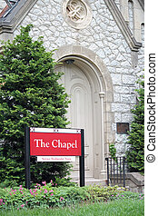 Chapel - The exterior of a chapel with a red sign in front