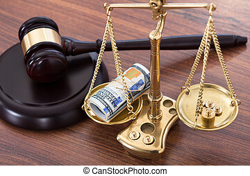 Gavel And Scales With Money On Desk - Judge gavel and scales...