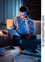 Businessman working overtime at home - Stressed businessman...