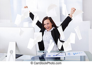 Successful Businesswoman Sitting At Computer Desk -...