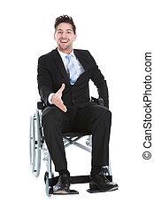 Businessman On Wheelchair Offering Handshake - Full length...