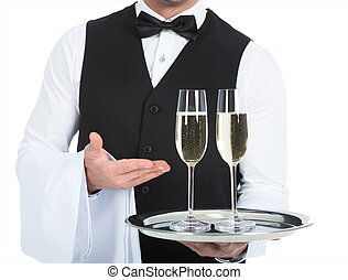 Waiter Carrying Champagne Flutes On Tray - Midsection of...
