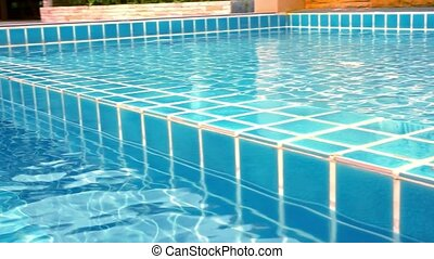 Clear blue swimming pool close up in tropical island at...