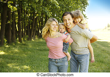 Young beautiful family outdoors - a Young beautiful family...