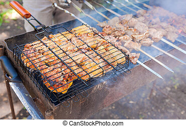 Appetizing fresh meat shish kebab prepared on a grill wood coal