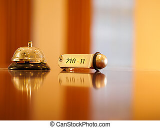 Hotel bell and key lying on the desk - Reception - Hotel...