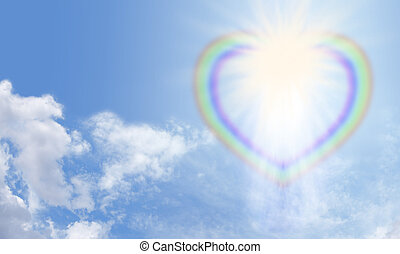 Divine Light - Heart rainbow bursting with light on a blue...