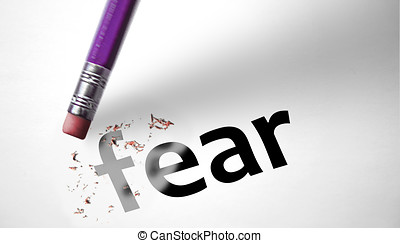 Eraser deleting the word Fear