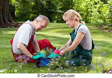 Couple spends his free time working in the garden