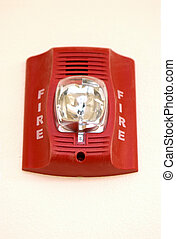 Building Fire Alarm - A red fire alarm hangs in an apartment...