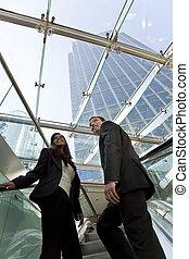 Executives on an Escalator
