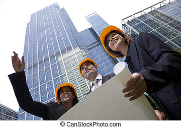 Executive Construction Team - A group of three executives,...