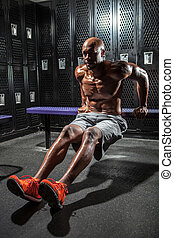 Locker Room Push Ups - Portrait of a lean toned and ripped...