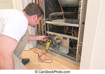 AC Repair Man - HVAC technician working on a residential...