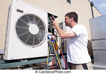 HVAC Technician - HVAC technician working on a mini-split...