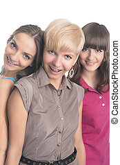Portrait of Three Young Ladies with Teeth Braces Together...
