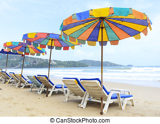 Camp Bed under the umbrella of colorful on beach Phuket,...