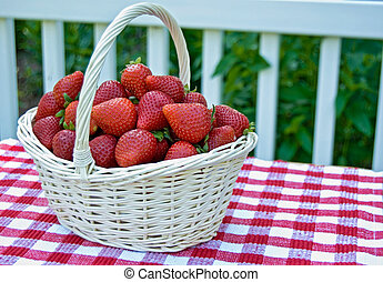 Nature\'s Candy - Summer strawberries in a wicker basket.