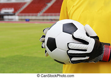 soccer goalkeeper with ball in his hand