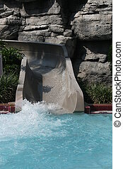 water slide - curvy water slide opening  into pool