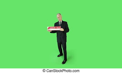 Senior caucasian business man green screen confident with garage sale sign