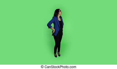 business woman isolated on green screen waiting