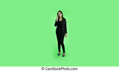 business woman isolated on green screen upset with phone
