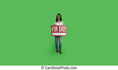 Casual woman isolated green screen confident for sale sign -...