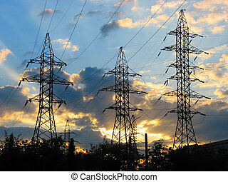 Electric Power Transmission Lines at Sunset - Electric Power...