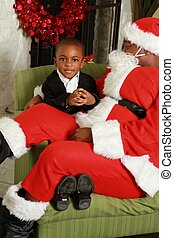Santa sitting on little boy's lap