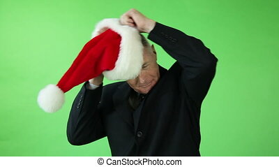christmas Senior caucasian business man green screen with santa claus