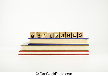 afrikaans language word on wood stamps and books - afrikaans...