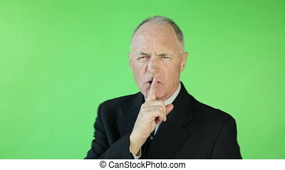 Senior caucasian business man green screen secrecy silence -...