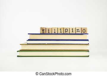 filipino language word on wood stamps and books - filipino...