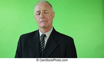 Senior caucasian business man green screen upset with gift -...