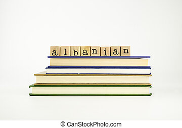 albanian language word on wood stamps and books - albanian...