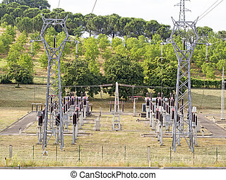 power plant with pylons and transformers, view from above -...