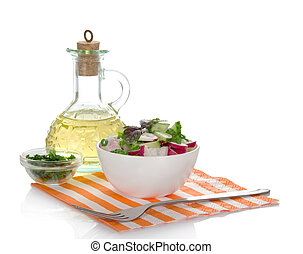Spring salad with radishes and cucumber - Jug of sunflower...