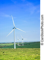 Scenic rural landscape with windmills, in summer